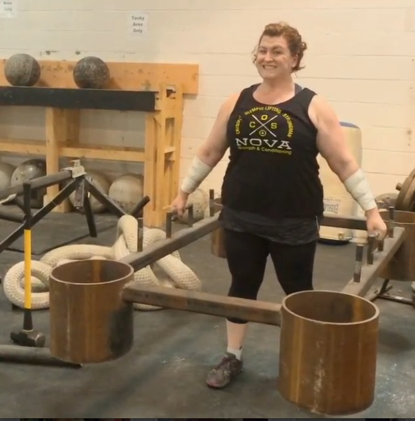 stacy lifts heavy steel thing